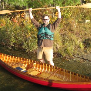 A happy customer with his new all-wood lapstrake Skimmer